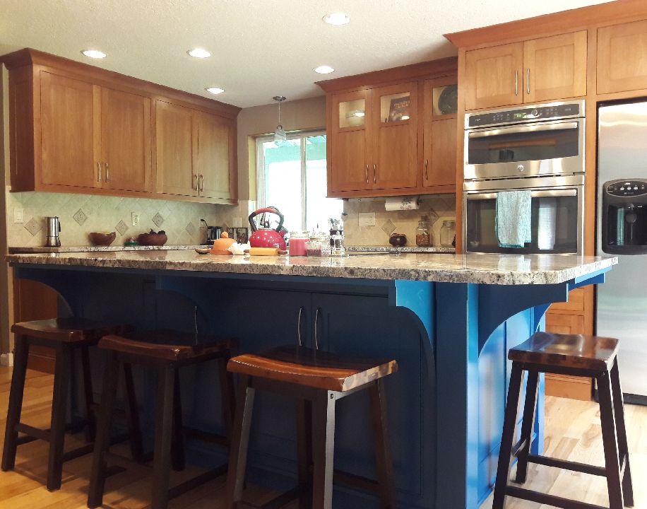 Light stained Cherry wall cabinetry with Blueberry Painted island